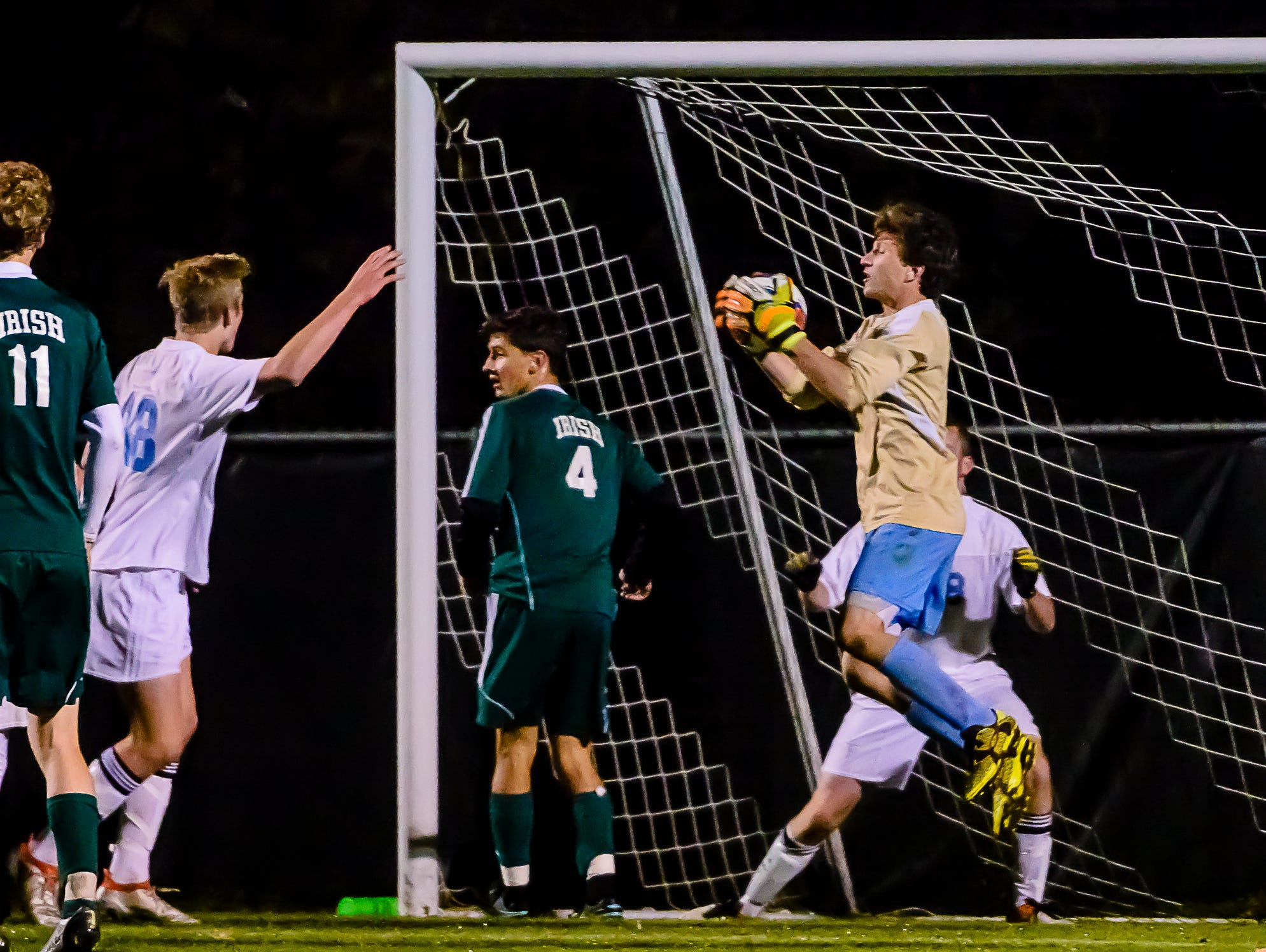 Lansing Catholic goalie Matthew Benivegna ,right, grabs the ball after a Gabriel Richard corner kick came close to scoring late in the 2nd half of their Division 3 regional quarterfinal game Tuesday October 25, 2016 in Williamston. KEVIN W. FOWLER PHOTO