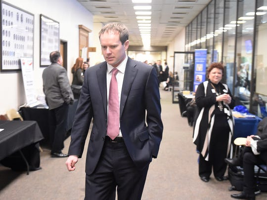 Jeremy Durham leaves a caucus meeting at Legislative