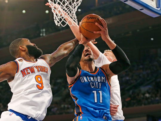 New York Knicks' center Kyle O'Quinn (9) and Knicks' forward Kristaps Porzingis (6) defend Oklahoma City Thunder center Enes Kanter (11) in the first half of an NBA basketball game in New York, Monday, Nov. 28, 2016. (AP Photo/Kathy Willens)