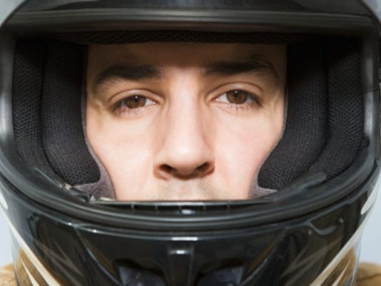 Man in a motorcycle helmet