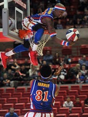 "TORIN HALSEY/TIMES RECORD NEWS The first basketball played at Kay Yeager Coliseum was the world-famous Harlem Globetrotters. Above, Randon ""Scorpion"" Dyer and Donte ""Hammer"" Harrison combine for a trick shot against the Washington Generals."