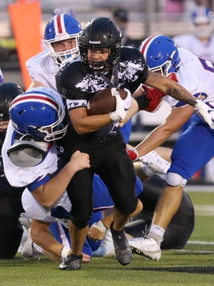 Perry's Devonte' Armstrong picks up yardage during Friday's game against Lake.