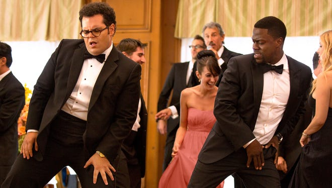 """Doug (Josh Gad, left) and Jimmy (Kevin Hart)  cut a rug in the upcoming comedy """"The Wedding Ringer."""""""