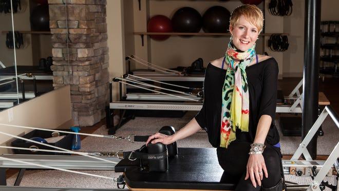 Tracy Janczak in her Core Rhythm Pilates Studio in Victor.