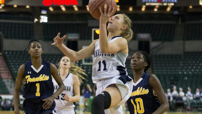 Manasquan's Stella Clark drives in on a fast break during first half action. Franklin vs Manasquan Girls Basketball in Tournament of Champions Final at  Sun Center in Trenton NJ on March 20, 2017