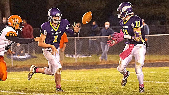 Bronson quarterback Jordan Shadix pitches to Justin Blankinship during the Viking win over Quincy on Friday.