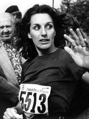 Women's division winner Erma Tranter waves after the first Detroit Free Press International Marathon in October 1978.