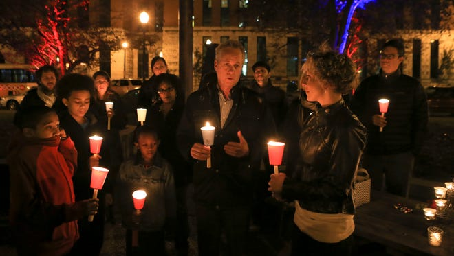 Louisville mayor Greg Fischer spoke during a vigil at Jefferson Square downtown for the victims of the Paris terrorist attacks.