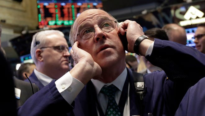 Trader Frederick Reimer works on the floor of the New York Stock Exchange on March 26.