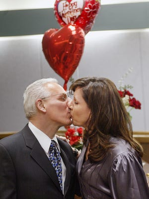 A kiss at the end of a wedding ceremony in Franklin Township's Council Chambers with Joseph Andruzzi and his wife, Mary McGuire.