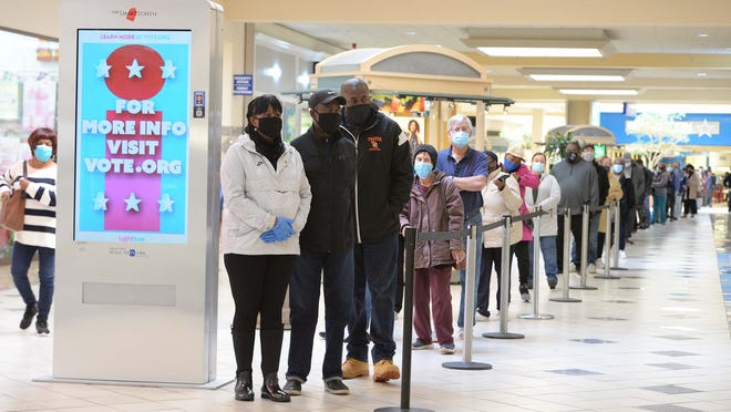 Long lines during early voting at the Westgate Mall  in Brockton, on Saturday, Oct. 17, 2020.