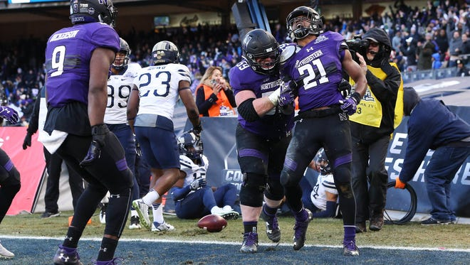 Northwestern Wildcats running back Justin Jackson (21) celebrates his touchdown against the Pittsburgh Panthers.