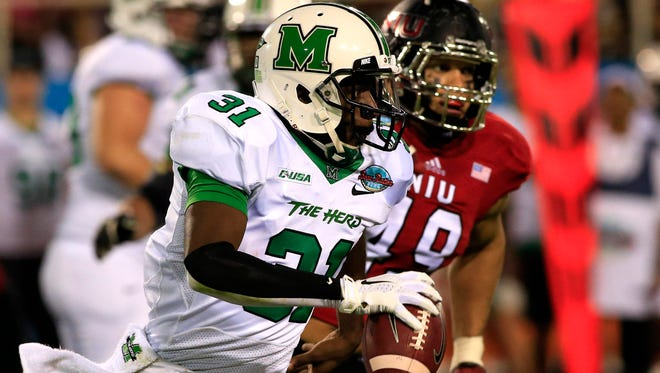 Dec 23, 2014; Boca Raton, FL, USA;  Marshall Thundering Herd quarterback Rakeem Cato (31) runs with the ball as Northern Illinois Huskies defensive end Jason Meehan (49) pursues in the second quarter against Northern Illinois Huskies in the Boca Raton Bowl at FAU Football Stadium. Mandatory Credit: Robert Mayer-USA TODAY Sports