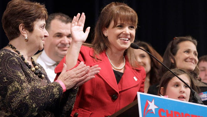 Delaware Republican Senate candidate Christine O'Donnell waves to supporters in Dover on Nov. 2, 2010. A judge has found O'Donnell violated federal law when she used campaign funds to pay rent at her Greenville townhouse.