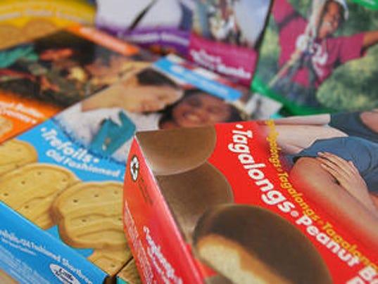 help our girl scouts   buy surplus cookies
