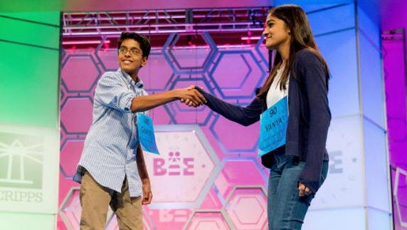 Vanya Shivashankar, right, 13, of Olathe, Kan., and Gokul Venkatachalam, 14, of St. Louis, shake hands as co-champions after winning the finals of the Scripps National Spelling Bee, Thursday, May 28, 2015, in Oxon Hill, Md.