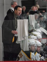 SNC coach Tim Coghlin yells instructions from the bench during the second period against St. Thomas.