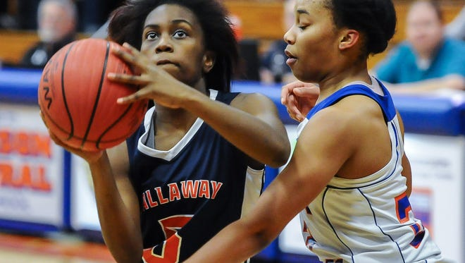 Callaway's Elisha Blackmon shoots against Madison Central's Christina Rouser during Friday's game. Blackmon finished with a game-high 14 point and five steals in the 49-41 win.