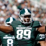 Michigan State's Shilique Calhoun celebrates his sack against Wyoming on Saturday, Sept. 27, 2014, in East Lansing.