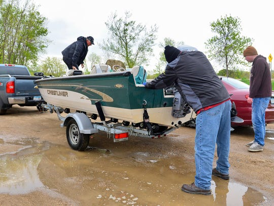 Brothers Duane and Don Hiltner pack up their boat Sunday