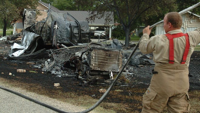 Firefighters quickly put out the flames that consumed an 18-wheeler that ran into a house Thursday off Hwy. 190 in Port Barre.