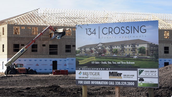 Work continues on the 134 Crossing apartment building development Saturday, March 11, in St. Cloud. A new report says while Stearns and Sherburne counties issued more permits to build multifamily units than two-thirds of Minnesota counties, the demand for affordable housing far outpaces supply.
