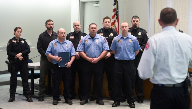 Waite Park police officers and firefighters are honored Wednesday, March 22 at Waite Park City Hall.