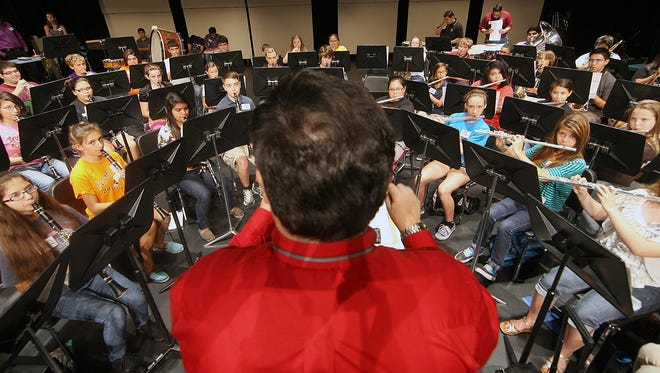 Abel Saldivar Ramirez with the Del Mar College music department (center) put dozens of Coastal Bend seventh through twelfth grader musicians through their paces during the 42nd annual Del Mar College Viking Summer Band camp Monday.