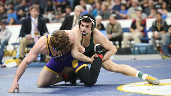 Brewster's Grant Cuomo wrestles in the 170-pound championship match of the NYSPHSAA Wrestling Championships at Times Union Center in Albany on Saturday, February 24, 2018.