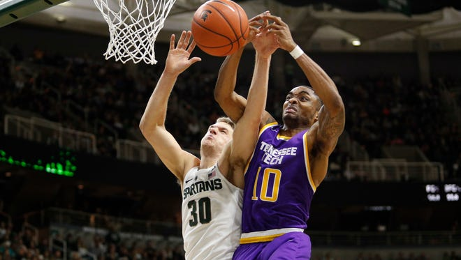 Michigan State's Matt Van Dyk (30) and Tennessee Tech's Kajon Mack (10) fight for a rebound during the second half of the Spartans' 71-63 win Saturday.