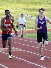 Norwich's Zack Race leads Binghamton's Sincere Williamson on his way to a win in the 100-meter dash Thursday at the STAC championship meet at Windsor High School.