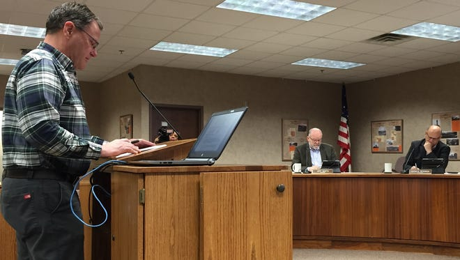 Bruce Danielson gives an assessment of last week's city-school board election to the Minnehaha County Commission on Tuesday morning.