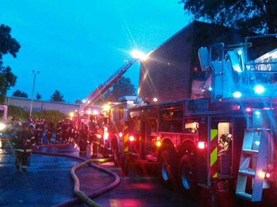 Firefighters respond to a fire at an abandoned inn on Harding Place Tuesday night, which investigators believe was deliberately started.