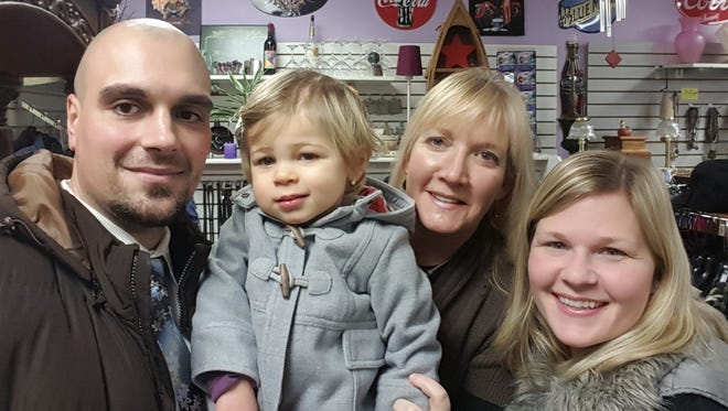 Joann Matthias (third from left), owner of Sunshine Gift & Consignment,  Brave Little Emma and her parents, Joel and Jess. Matthias became friendly with the family after working on fundraisers for the youngster.