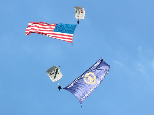 The Walleyes for Wounded Heroes finale included a patriotic skydiving performance from Team Fastrax in honor of Purple Heart recipients and Gold Star families of fallen heroes.