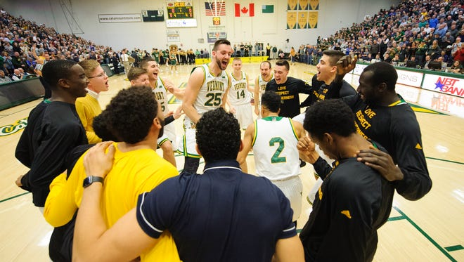 Vermont huddles together before the men's basketball game between the Binghamton Bearcats and the Vermont Catamounts at Patrick Gym on Wednesday night.
