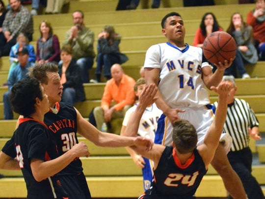 Mesilla Valley Christian's Jeremy Frazier goes up for