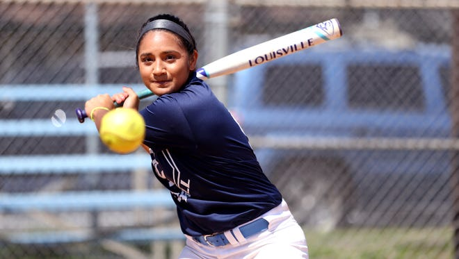 Carroll High School softball player Kelli Serrato participates in batting practice on Monday, April 25, 2017.