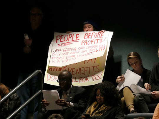 Some attendees showed their opposition to a soccer stadium in the West End during a Cincinnati school board meeting Feb. 12, 2018.