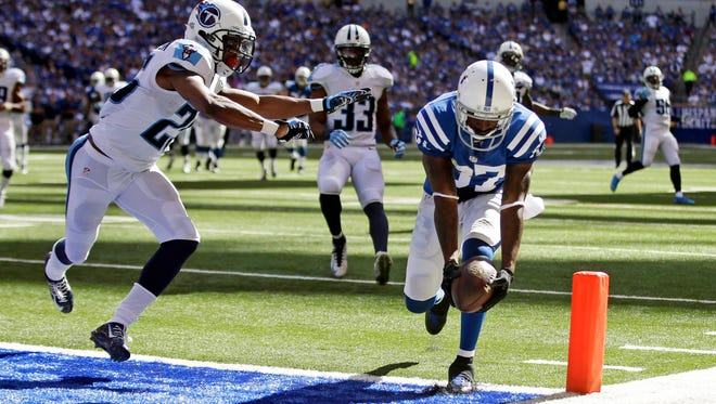 Colts wide receiver Reggie Wayne scores a touchdown on a 28-yard catch in front of Titans cornerback Blidi Wreh-Wilson in the second half Sunday.
