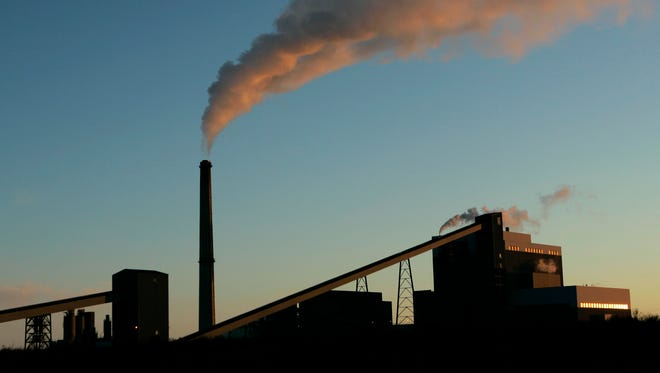 A coal-fired power plant churns out electricity in this Friday, Feb. 2, 2007, file photo in Holcomb, Kan. Carbon dioxide emissions will remain in Earth's atmosphere for hundreds of years.