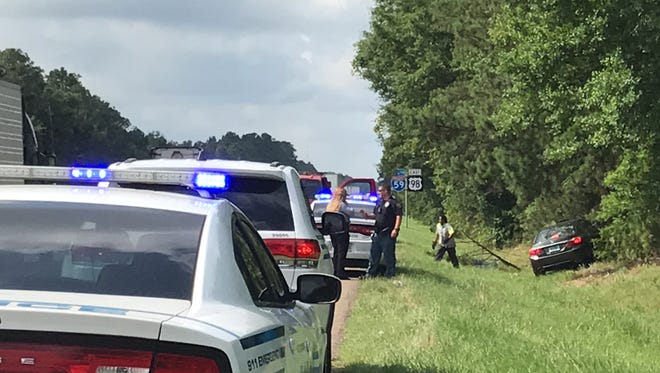 Hattiesburg police investigate the scene of a one-vehicle crash on southbound Interstate 59 near the Hardy Street exit that left one man seriously injured on Wednesday, May 30, 2018.