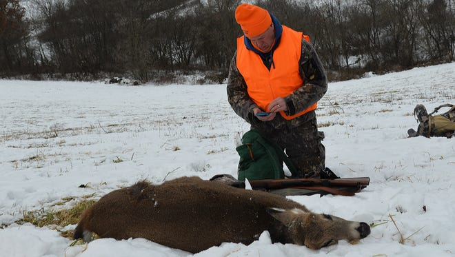 Most Wisconsin deer hunters register their deer online with a computer or smartphone, with many completing the mandatory task before dragging out their kill.