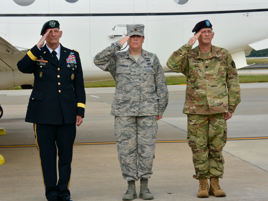 At left, retired U.S. Army Lt. Gen. Keith M. Huber, MTSU senior adviser for veterans and leadership initiatives, salutes along with Army and Air Force officers Wednesday, Sept. 28, at Dover Air Force Base as the remains of American soldiers from the Mexican-American War were returned to the U.S.