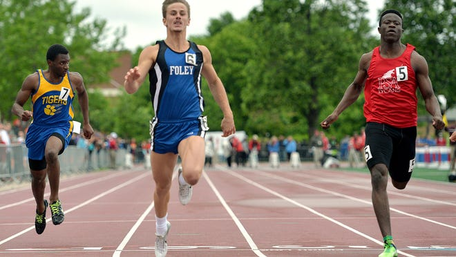 Foley's Tyler Beehler finishes just ahead of Prairie Seeds Academy's Moise CJ Damey in the 100-meter dash in the Class A state track and field meet Saturday at Hamline University in St. Paul. Beehler finished first with a time of 11.02 seconds.