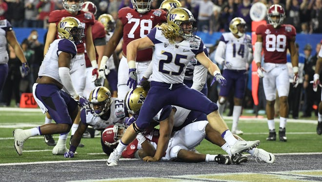 Washington linebacker Ben Burr-Kirven celebrates after a stop against Alabama during their College Football Playoff semifinal at the Peach Bowl.