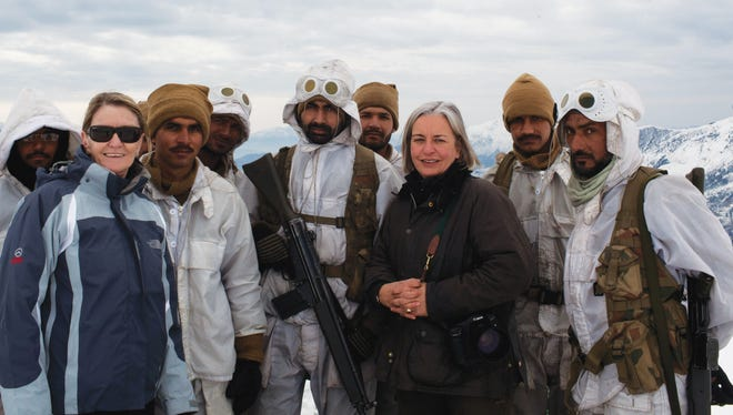 Kathy Gannon, front left, AP special correspondent for Afghanistan and Pakistan, and veteran AP photographer Anja Niedringhaus, third right, pose with Pakistani soldiers in the remote border area opposite Afghanistan's northeastern Kunar province in February 2012. The AP team was documenting Pakistan's role in fighting Islamist militants in the region.