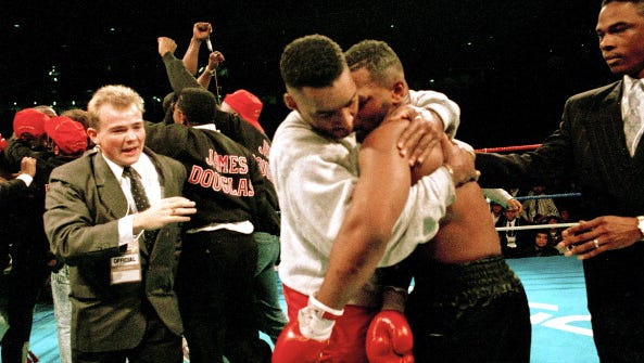 American boxers James 'Buster' Douglas (left) and Mike Tyson embrace after their world heavyweight title fight at the Tokyo Dome in Tokyo, Japan, 11th February 1990. Douglas won by a knockout in the 10th round in one of the biggest upsets in boxing history.