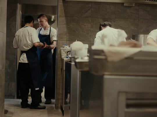 Daniel Ernce, at rear of photo, worked alongside young chefs from many countries during a competitive internship at 108, a Michelin-star restaurant in Copenhagen, Denmark.