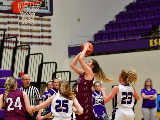 Madison's Nicole Brown goes up for a shot against Belle